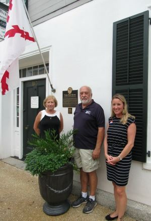 Judy Riggle Poses with Marker Installer Darrel Galles and Historic Preservation Officer Jenny Wolfe
