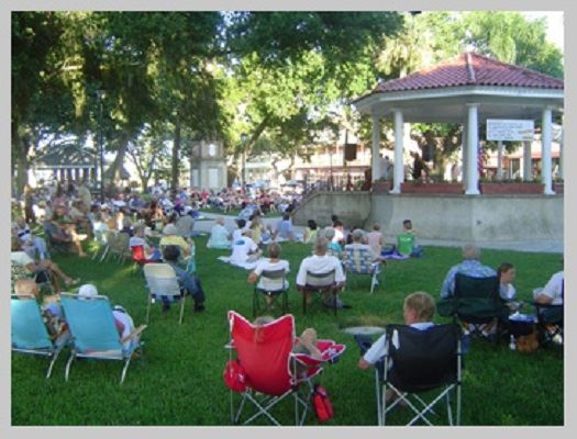 photo of people watching Concerts in the Plaza at the Gazebo